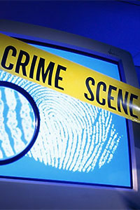 Crime scene tape over a monitor with a fingerprint.