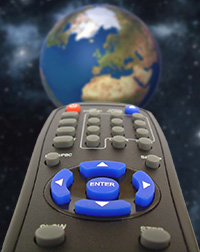 Remote control pointing at planet Earth.